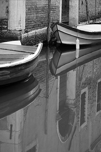 Still waters in the canals of Venice.