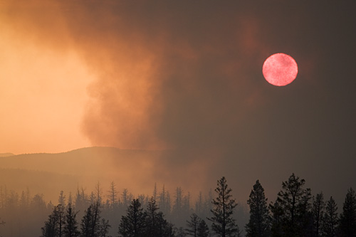 The sun is obscured by the heavy smoke.